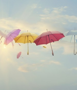 abstract images of umbrellas floating, protecting physicians against claims that arise even after insurance policy is cancelled