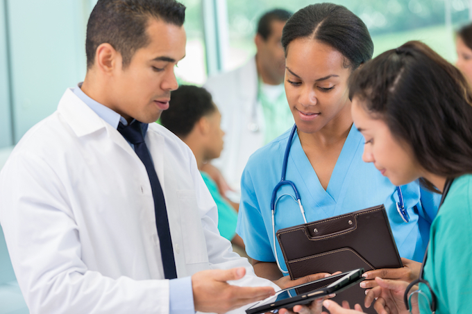 physicians conferring on patient transfers
