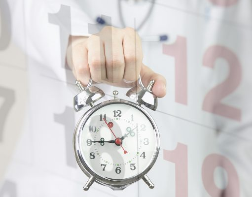 Hospitalist shift length; Medical background doctor with clock and calendar
